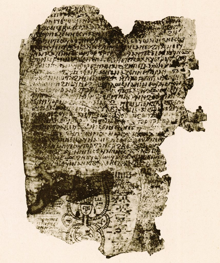 A damaged Coptic parchment, with an image at the bottom of a figure with striated, tube-like appendages, surrounded by characters (magical signs).