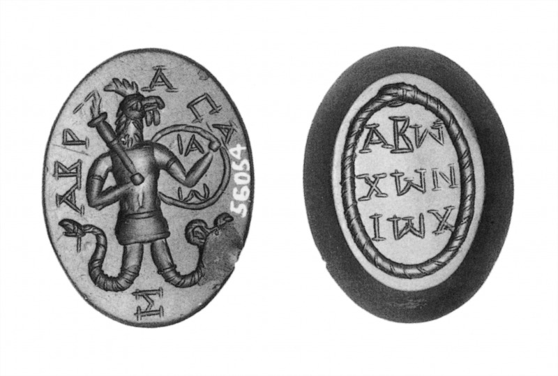 Black and white image of an oval gem, with a rooster-headed man with snake-legs holding a club or torch and shield on one side, surrounded by Greek writing. On the other side, a snake swallowing its own tail surrounds three more lines of Greek text.