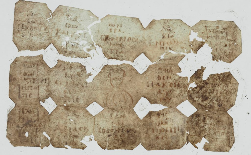An image of a damaged sheet of parchment, folded three times vertically and five times horizontally.. Each of the sections created by the folds has a short Greek text written in it, except the central square, which has a human torso drawn. The spaces between the sections have been cut to produce diamond shapes.