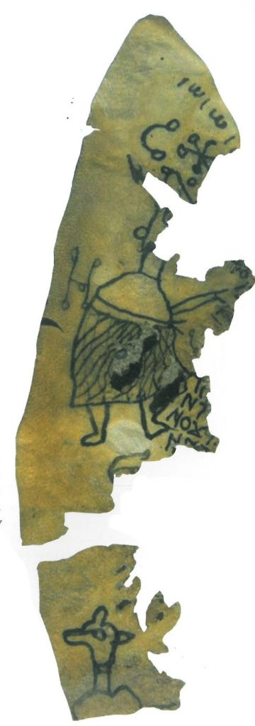 Fragments of a triangular shaped parchement text. Two fragmentary humanoid figures can be seen, one with what looks like the head of a dog, as well as some magical symbols and Coptic text.