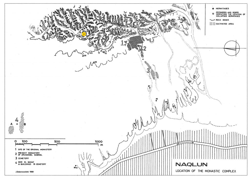 Line drawing of the site of Naqlun. The monastery is east of the mountains; to the west is a desert and then the cultivated land. A yellow dot marks the location of Hermitage 44 north of the monastery, just on the east side of the mountain.