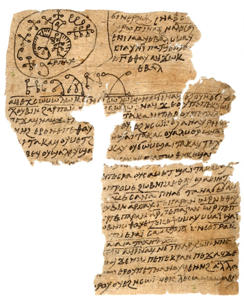 An image of a sheet of rag paper, badly damaged at the top-right and bottom-left. The sheet has Coptic writing and magical signs on it, while at the top left there is an image of a highly-stylised bird.