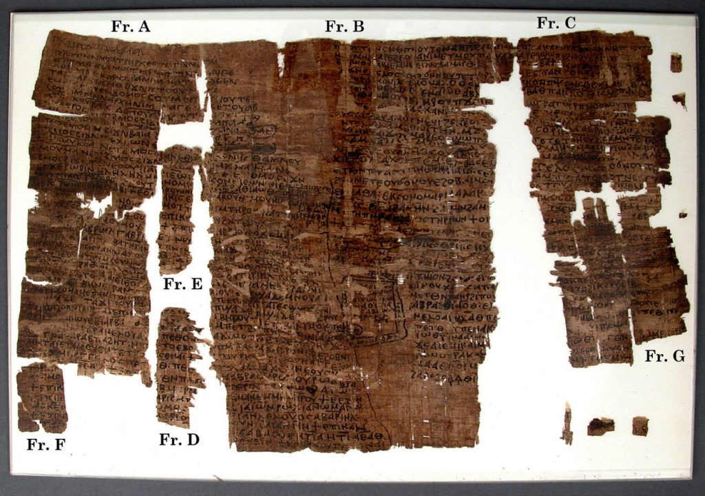 A fragmentary, dark brown papyrus, with Coptic written in two columns.