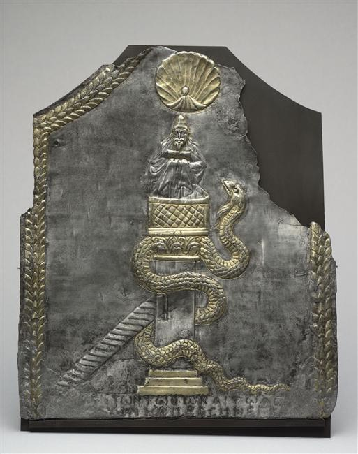 Ex-voto as a plaque of Simeon stylites. From the treasure of the church of Ma'aret in Noman in Syria. End of 6th century after J.-C. Gilded silver. Height: 26.9 cm; width: 25.5 cm. With a Greek inscription: With thanks to God and Saint-Simeon, I offered <the present object>. Louvre museum.  Description from https://commons.wikimedia.org/wiki/File:Plaque_de_Saint-Simeon_(Louvre,_Bj_2180).jpg
